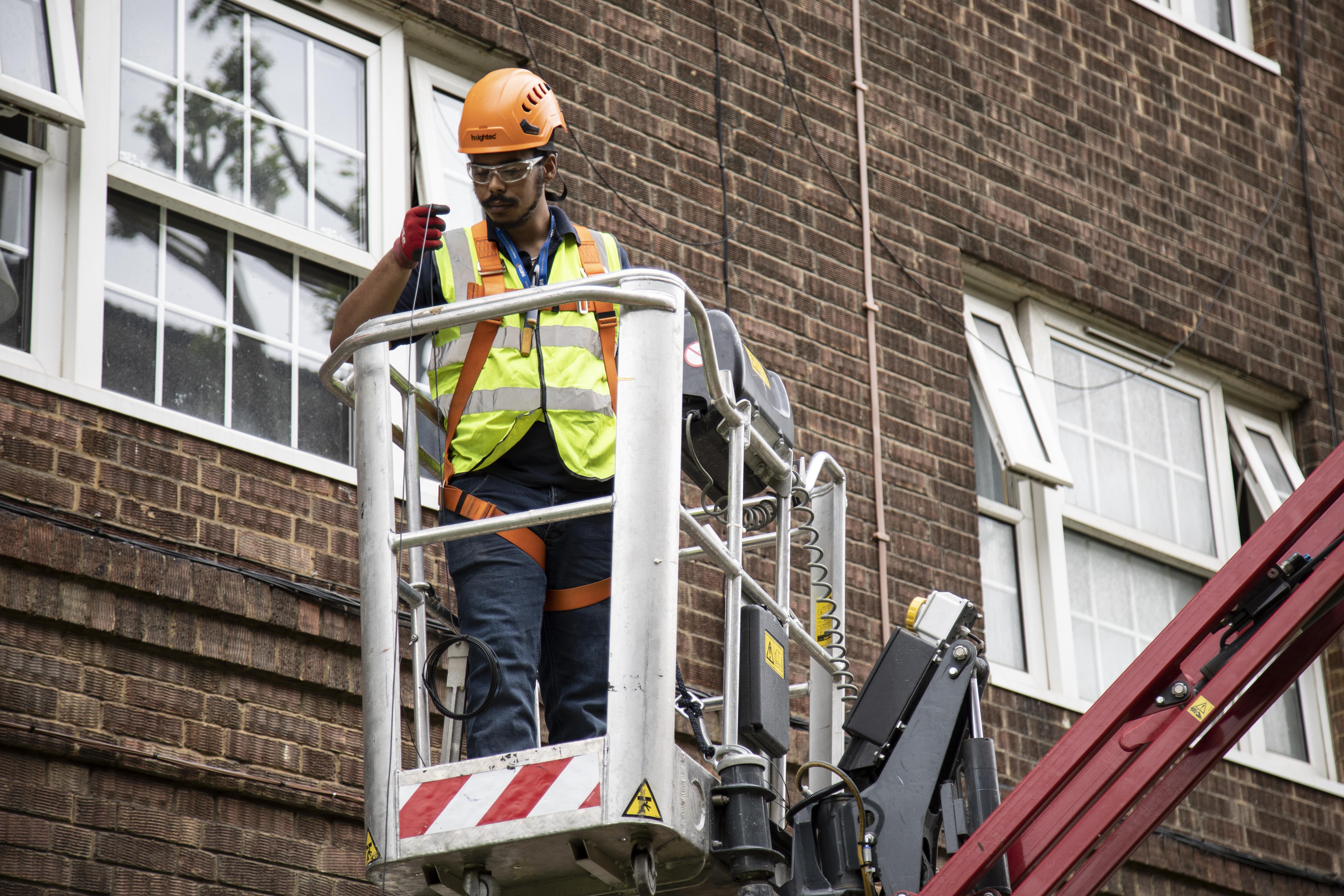 engineer MEWP london fibre install